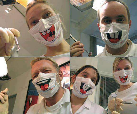 Surgical masks with funny cartoon mouth for dentists